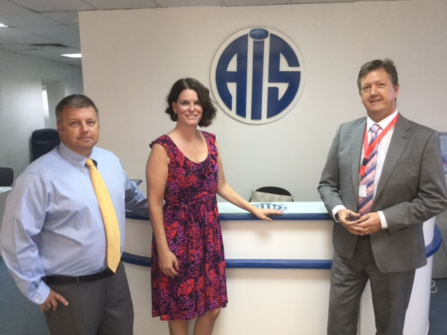 From left: American International School Director Mark Lentz and Renne Gian with Bill Turner