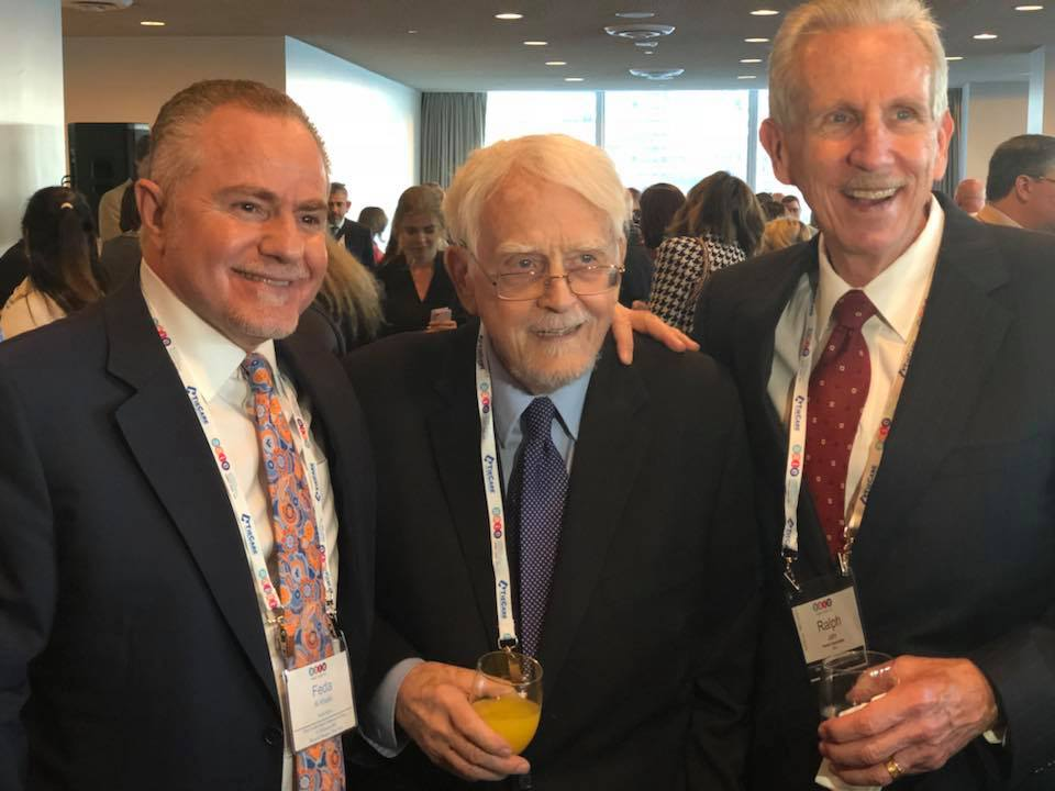 Founder John Magagna (middle) and Ralph Jahr (right) strike a smile during the Welcome Reception