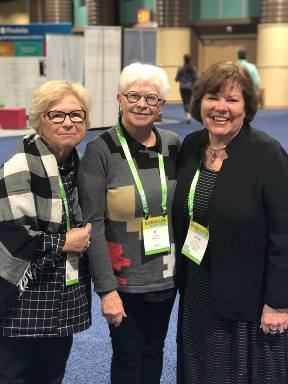 Julie (at right) reconnecting with two former colleagues from the American School in London