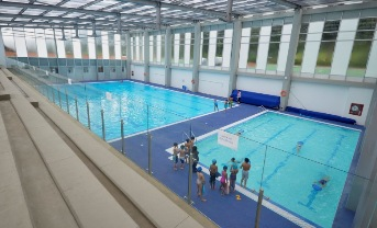 Acquatic center, with 2 pools & 21 showers heated by solar collectors & electric heat pumps, also serves the curriculum.